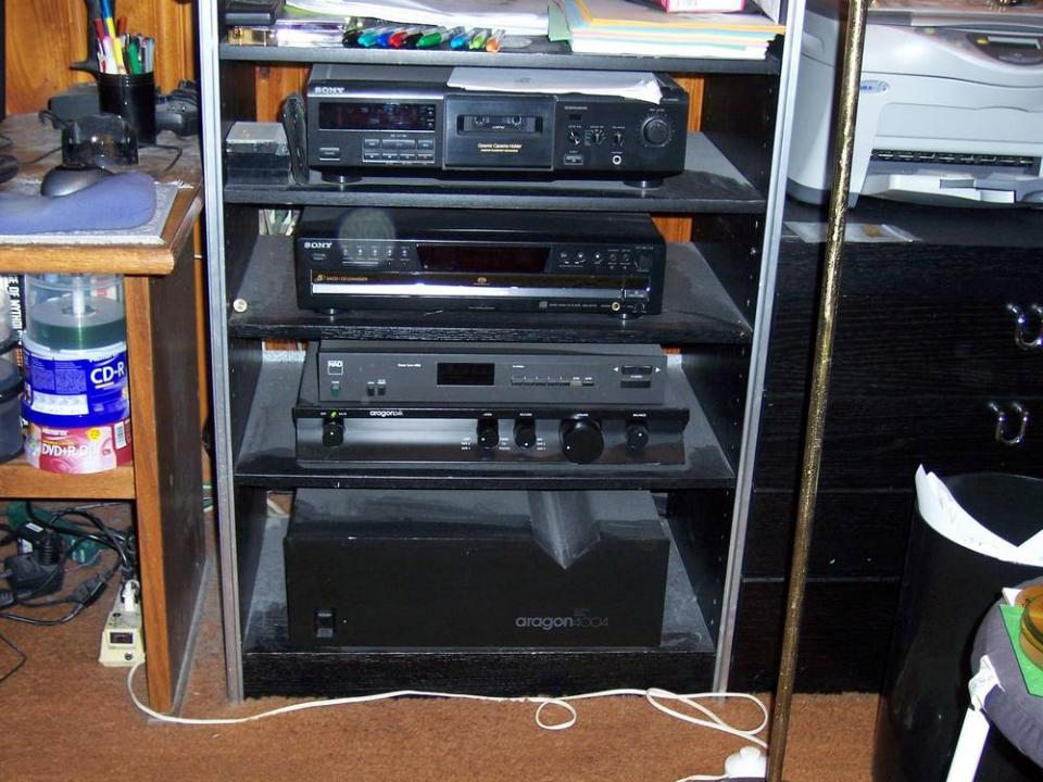sound system components. these are the components of my computer audio system. starting from top: sony cassette deck, scd-ce775 5-disc sacd player, nad 4130 tuner, sound system